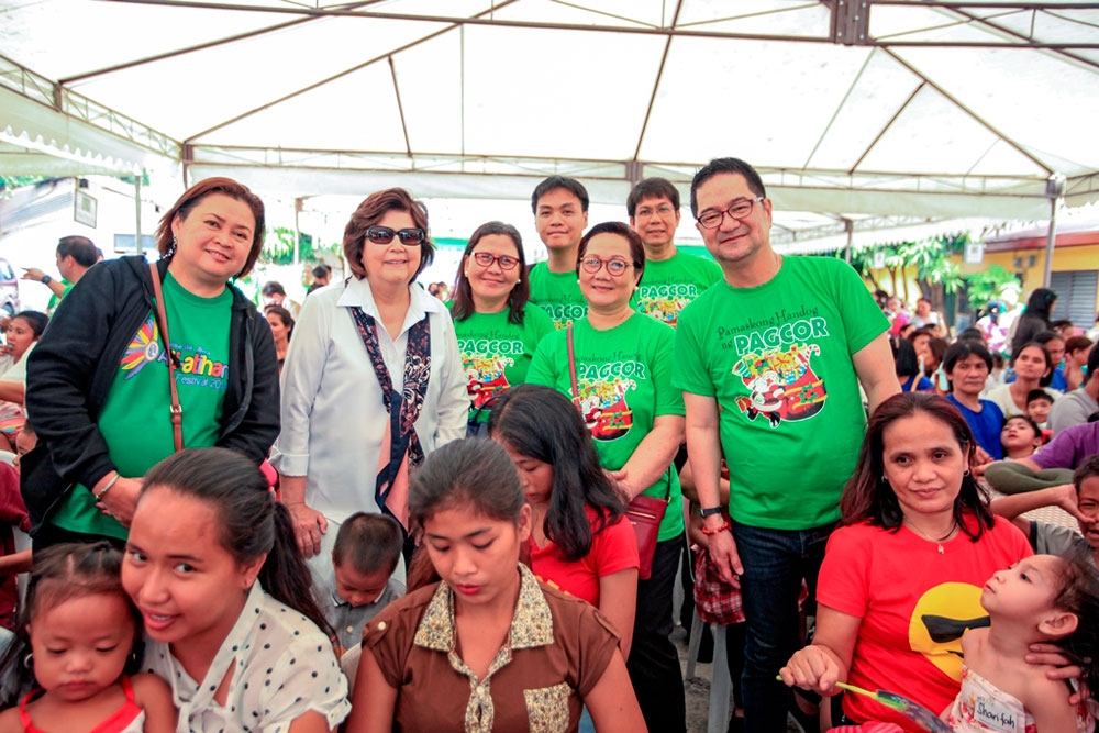 Less privileged families receive Christmas presents from PAGCOR