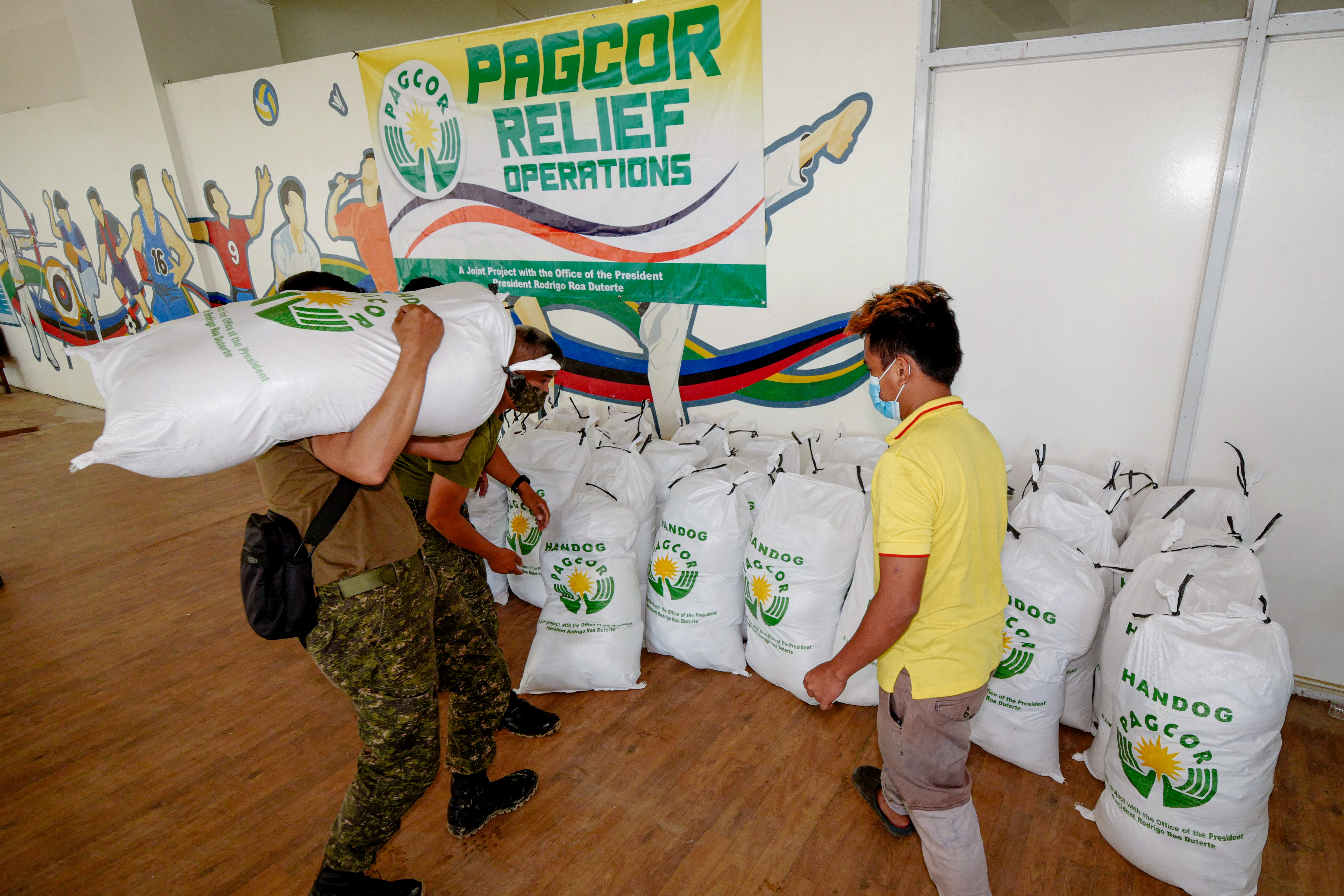 PAGCOR brings aid to flood victims in Marikina